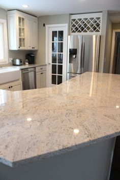 the lightest granite we could find and had more movement than typical granite, more like a marble or quartzite. It is called Cielo Merfil and we got it at a local shop called Damar Stone.