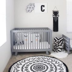 Black and White Nursery The rug - SwimZip Roundie - pulls the whole room together. Love the Grey, Crome, Black, White Baby Room. Great Monochrome Nursery