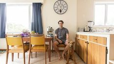 Survivor NZ contestant Josh Hickford in his kitchen, which features a retro mustard dining table.