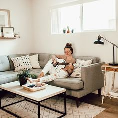 taking a break from my to do list that is about a million miles long😴 on the bright side our apartment is finally feeling like a home. I'm loving it! cutest pillows from @maewoven ❤️