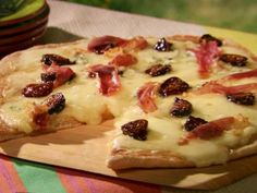 Four Cheese Pizza with Fig and Prosciutto from Jen Cook, guest on Grill It! with Bobby Flay show, 4 1/2 of 5 Stars, 5 Reviews | Food Network. Note: Uses fresh figs or dried figs soaked in apple juice, fontina, Gruyere, mozzarella and blue cheese.