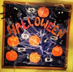 Halloween display board - nursery, pre school. Halloween crafts - ghostly feet, pumpkin collage, spider hands