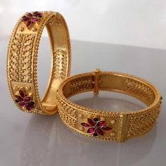 Buy traditional carved broad bangles in temple jewellery online . Madhurya offers wide range of temple jewellery bangles, earrings, necklaces at best price. Gold Bangles Design, Gold Jewellery Design, Gold Jewelry Simple, Kerala Jewellery, India Jewelry, Temple Jewellery, Fine Jewelry, Gold Bracelet Indian, Silver Bracelets