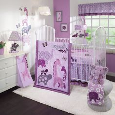 Purple baby girl nursery decorating ideas with jungle themes giraffe elephant crocodile and butterfly
