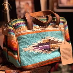The Barstow - Serape tapestry makeup bag. Turquoise and earth tone southwest pattern with a saddle blanket look. Soft distressed leather handles and pipe trim. Fabric lined interior with two slip pockets. Leather Handle, Leather Purses, Leather Bag, Mode Country, Boho Chique, Savannah Sevens, Saddle Blanket, Travel Cosmetic Bags, Travel Bag