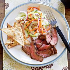 Hoisin Flank Steak with Asian Cucumber Salad  Enjoy a quick steak dinner infused with fragrant Asian flavor. Spiced wonton chips that bake while the steak rests are an easy accompaniment.