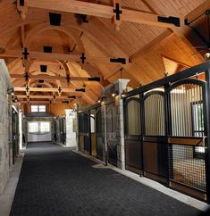 Love the arches in the barn aisleway and the stalls. Lucas Equine horse stalls.