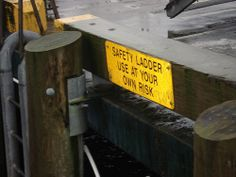 "I saw this sign on a ""safety ladder"" in Ketchikan, Alaska durring the Age Group Championship swim meet last December. It was about 20 feet above the ocean on an old dock.   Funny - Hilarious Signs & Billboards"