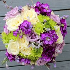 Happy anniversary to Allie! Shades of purple and lavender with a touch of lime green and ivory. What an awesome way to change up the classic purple bouquet!  #thefloralcottageflorist #batonrougeweddings #neworleanswedding #weddingflowers #throwbackthursday #bridalbouquet #frenchlavender #purplewedding