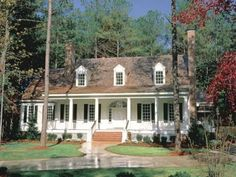 A wide front porch.  traditional exterior Cape Cod/ Colonial
