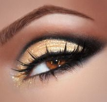 Pale gold, copper, and black eye shadow colors