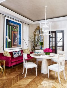 In the dining room, European antiques mingle effortlessly with shapely modernist pieces. Gustavian chairs in a Jasper leather; vintage Edward Wormley for Dunbar sofa in a Lelievre velvet; chandelier, Stephen Antonson; wallcovering, Holland & Sherry; photograph, Robert Polidori. - Veranda.com