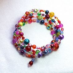memory wire bracelet with clasp | Glass bead bracelet - memory wire - 'Festival' - multicoloured - Free ...