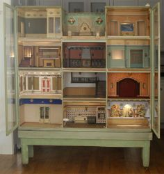 Spanish Cabinet Dollhouse..Details of this art deco-era (circa 1925-30) mansion include wooden construction of the house and original base, eleven beautifully appointe...