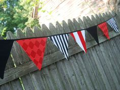 Boy's Pirate Banner, Birthday Party Bunting, Party Flags, Photo Prop, Pirate Wedding Decor  -- in red, black and white fabric flags. $30.00, via Etsy.