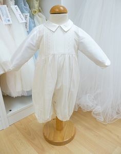 Only available at Tots & Frocks, this adorable romper is perfect for Christenings, Naming Days, Baptisms, weddings and special occasions. A smart all in one with long sleeves and legs that is fully lined so perfect for the colder months. The romper has a pin tuck and embroidered pattern on the chest and piped detail on the front of each leg. It has a button fastening at the rear to the small of the back and on the legs for ease of changing.
