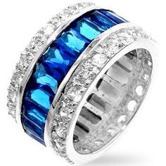Triple Row Sapphire Eternity Band Our genuine rhodium finish is achieved using an electroplating process that coats the item with heavy layers of rhodium, a close cousin to platinum, which gives our jewelry a platinum luster. Sapphire Eternity Band, Eternity Bands, Wide Band Rings, The Ordinary, Blue Sapphire, Sterling Silver Jewelry, Diamond, Radiant Cut, Cocktail