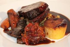 Succulent Shoulder of Lamb with tasty seasonal vegetables, fondant potato and spiced apricot chutney.