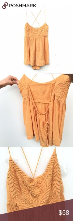 Free People Blackbird Embroidered Babydoll Top Brand new and without tags gold / orange-yellow Free People tank top. Straps are yarn like and cross over in back as shown. Straps are adjustable. Free People Tops Tank Tops