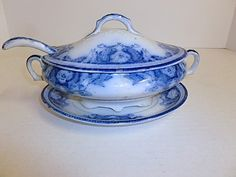 Awwwwwwesome 1840s English Staffordshire Sauce tureen..... FOUR pieces, very hard to find!!! The ladle, the top, the bottom, and the saucer.  Sauce tureen is 9 inches long, handle to handle.  Sauce tureens are smaller than the large soup tureens. Marked semi porcelain and Paris on bottom