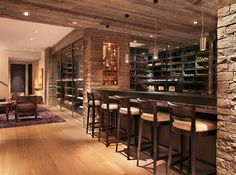 Love the stone columns on either side of the bar, especially if goes with a stone arch entrance to wine cellar