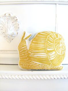 Plush Yellow Snail Pillow. Woodblock Printed. Customizable Colors. Made to Order.. $16.50, via Etsy.