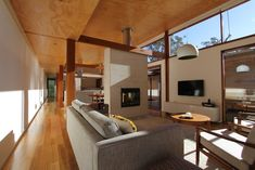 Anthony Knobel Architect - fire in thermal mass.  Like the mix of wood and white walls.  nice light generated in the room