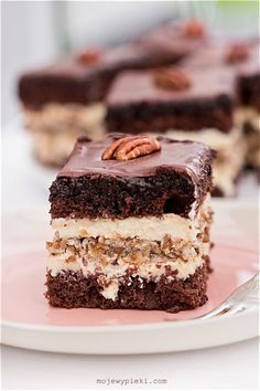 chocolate sponge cake with pecans and custard filling topped with chocolate ganache