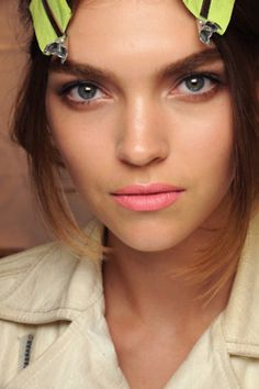 Blend a touch of concealer or highlighter at the bow of your lips and right under the lower lip.