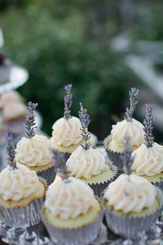 Lavender sprig on top of cupcakes. Photography by / swoonbykatie.com, Cupcakes by / frostme.net