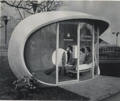 space-age-planet:    Two couples in a futuristic family telephone booth at the New York World's Fair