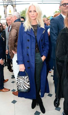 ELLE loves... Poppy Delevinge on the FROW at the Burberry Spring Summer 2016 show at London Fashion Week. Poppy wears a bold blue trench coat with a black lace top and smart trousers. Her tasselled boots and zebra print bucket bag accessorise this outfit perfectly!