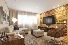 cortina de trilho para sala com detalhes marrom