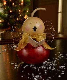 The new caroling angels are singing songs and spreading joy. They each come with gold bows and gold wings. The small and medium natural colored angels come with a song book.