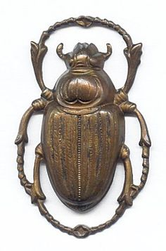 59080  Vintage Large Scarab Beetle Pendant  Highly valued by the Egyptians for their cyclical qualities, the scarab is recreated here in vintage brass with beautiful detail.  This beetle pendant easily stands alone as the focal of a necklace, or create a pair of statement earrings with two of them.