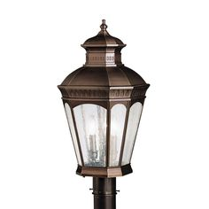 This Traditional 2-light outdoor ceiling flush mount features a burnished bronze finish that will compliment many outdoor decors. The clear seedy glass enhances the look.