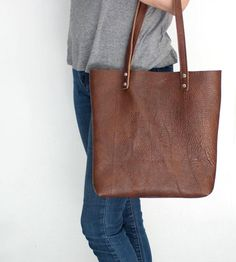 Invest in a new bag without a hint of buyer's remorse by going back to basics with a simple leather tote.