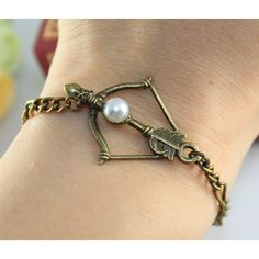 So pretty!! :) I want this!!  The Hunger Games Inspired BOW, with peeta pearl bracelet found on Polyvore