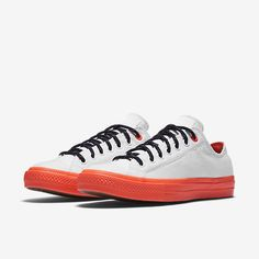Orange is strong but tamed by clean upper and black accents. Chuck II with Shield Canvas.