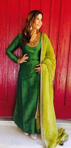 Green silk kameez with gold embroidery. Lime green dupatta.