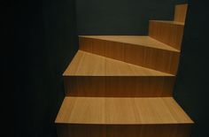 #tisselli studio wood steps in a black space
