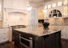 Classic Style Cabinetry | Walker Woodworking ~ We love everything about this Kitchen, especially the arched hutch area with the cubbys and glass doors.
