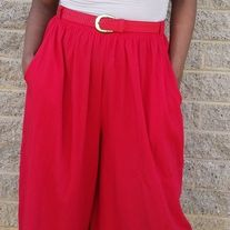 Women's size 12 (Waist 30 inches, Hips 39.5 inches)  These incredible bold red vintage gaucho pants are an eclectic addition to your wardrobe. Adorned with matching red belt with gold detail, you can wear these casually or dress them up. Pair these gaucho pants with a pair of flats, sandals, o...