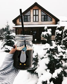 cold coffee in front of a winter ski chalet