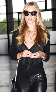 Rosie Huntington-Whiteley in black sunglasses and black leather skinnies.