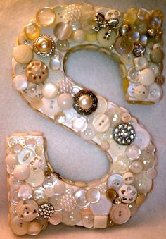 crafts -cover large letter with variety of buttons. I think this would look great in colored buttons to match room decor