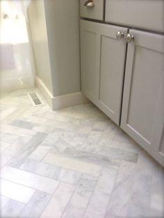 marble 3x12 herringbone floors. Love this idea!
