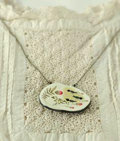 Paper clay pendants by Elsa Mora