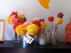 yarn centerpieces are one of the easiest DIY projects and will be the perfect alternative to flowers.