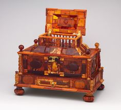 """Casket, ca. 1680 Michel Redlin (German, documented 1688) Poland (Gdansk) Amber, gold foil, gilded brass, wood;    Amber was regarded as a substance of mythical origin and magical power. This parade casket is one of the most important and best preserved examples of amber work to have survived from the seventeenth century. Michel Redlin is documented as an """"amber carver"""" in Gdansk in 1688. In this casket, Redlin incorporated nearly all types of amber—translucent, opaque etc"""